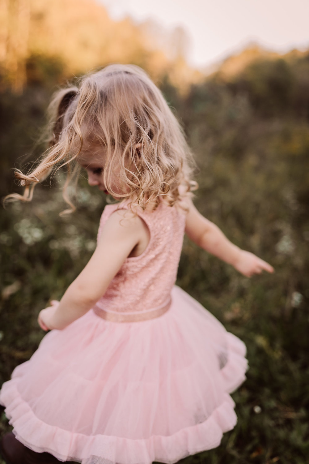 little girl twirling