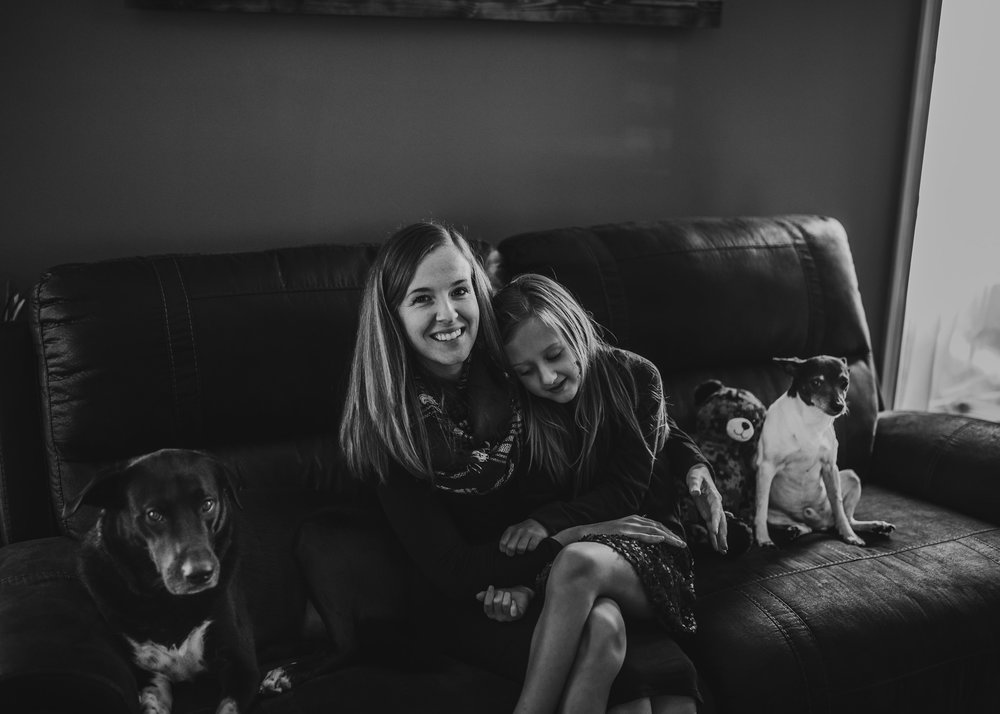 lifestyle session of mom and daughter with dogs deployed husband