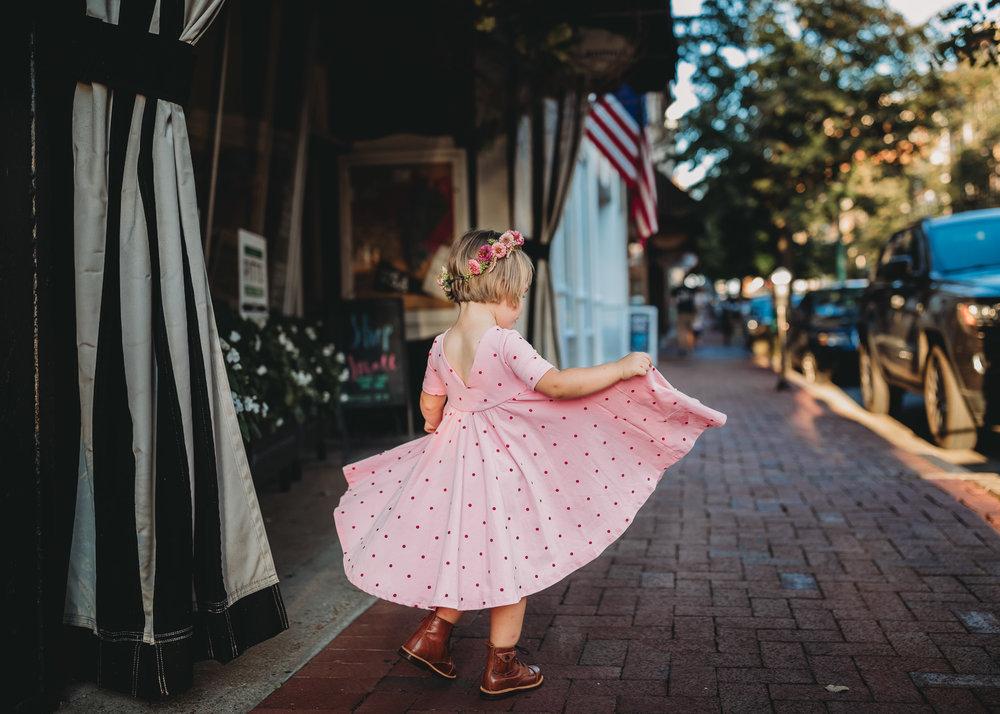 little girl twirling