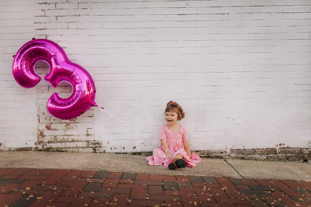 little girl and 3 balloon