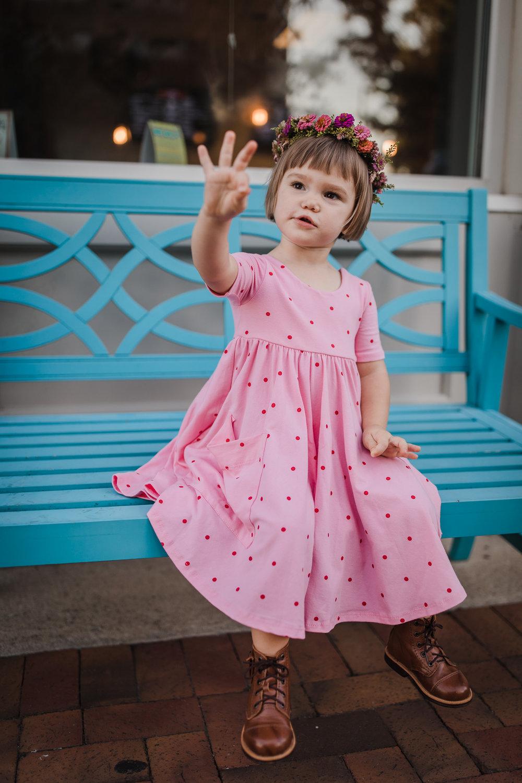 little girl holding up 3