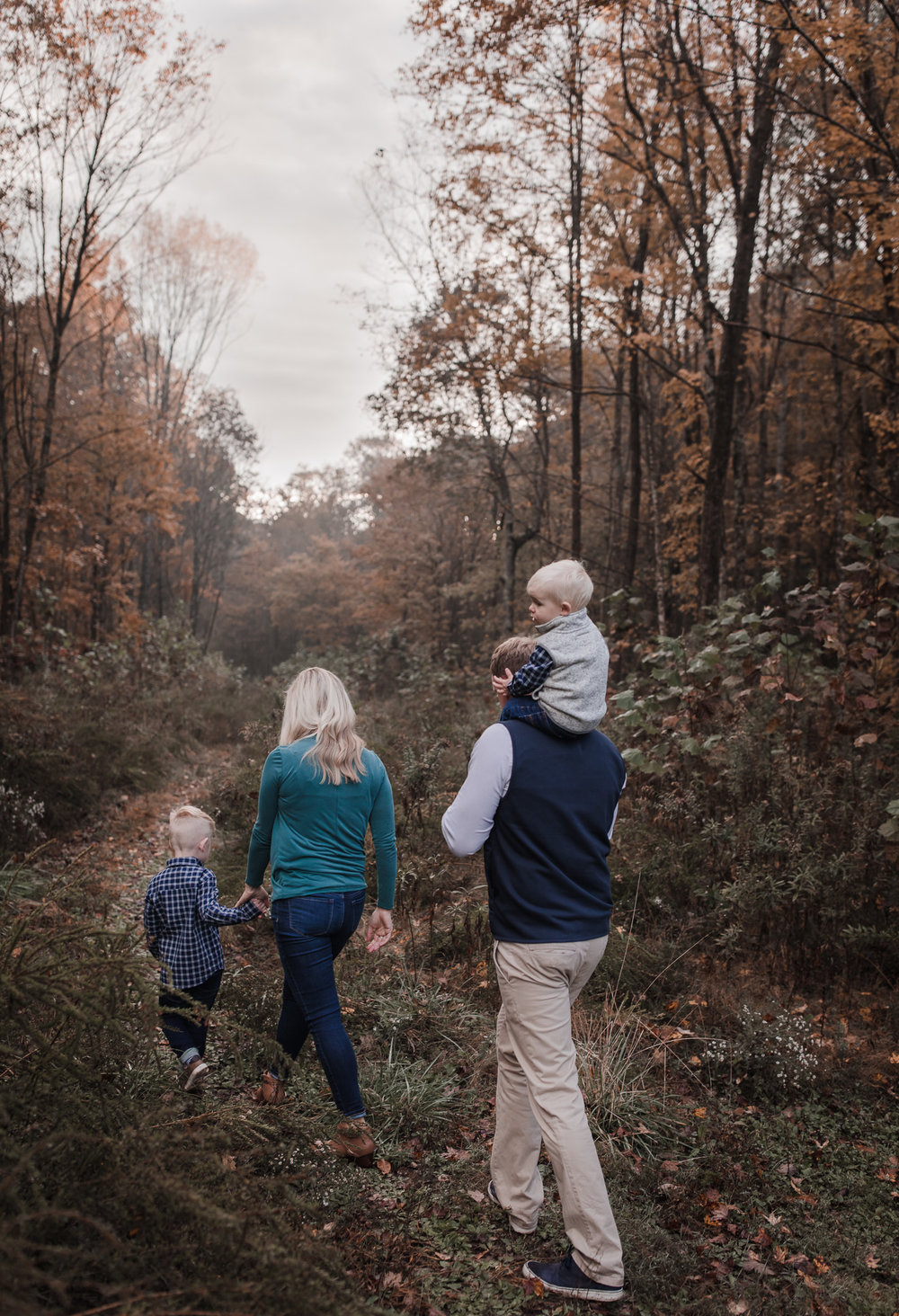 walking family of four photo pose