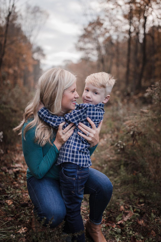 mom hugging toddler son