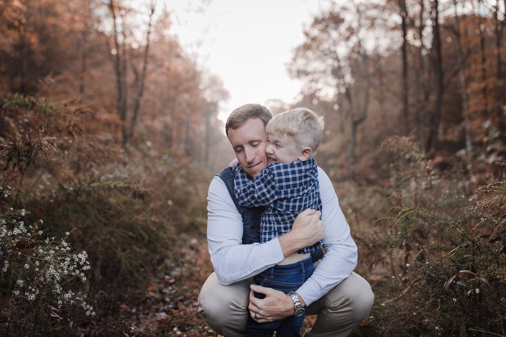 dad hugging toddler son