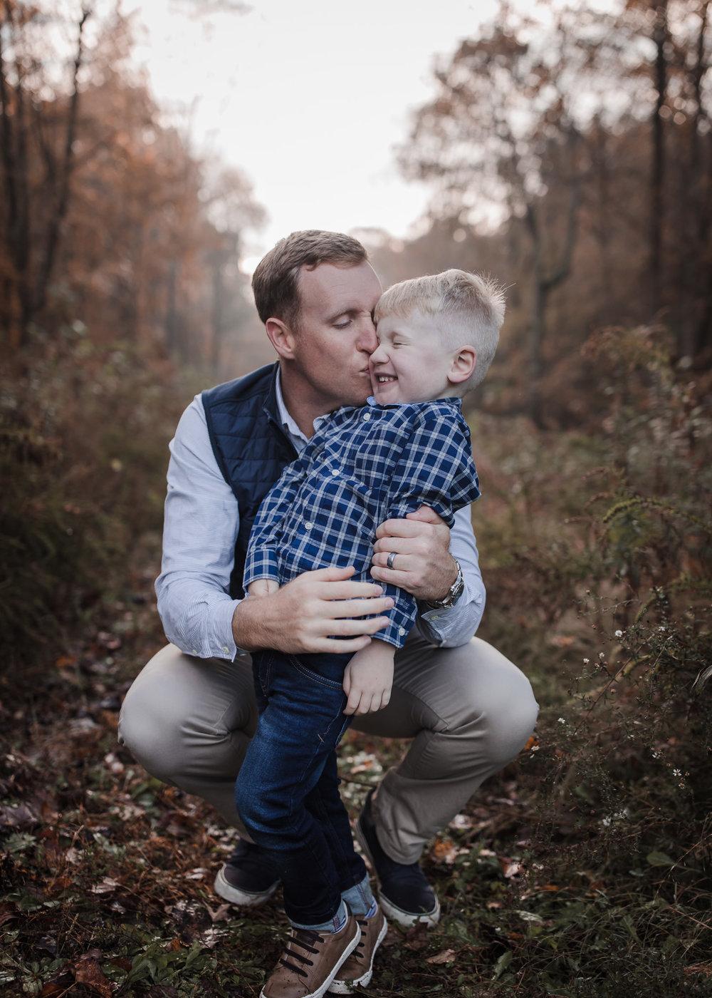 dad kissing toddler son