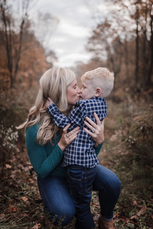 mom kissing toddler son