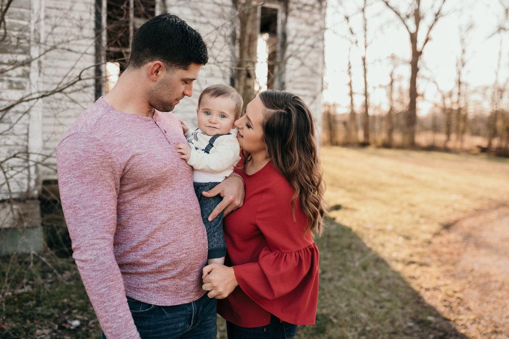 Family Photo Holding Child