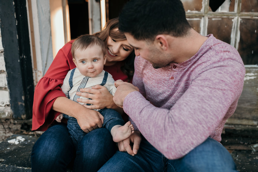 Couple Sitting and Holding Child