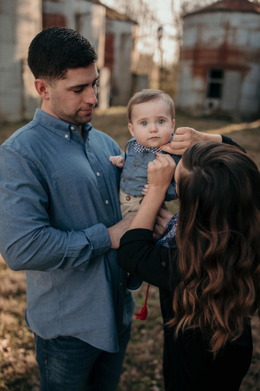Couple Holding Child