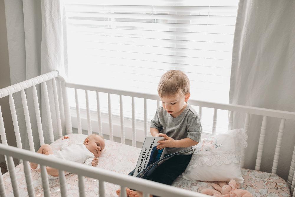 Siblings in Crib