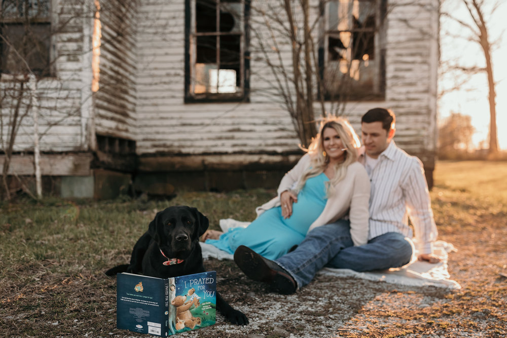Couple Sitting with Dog