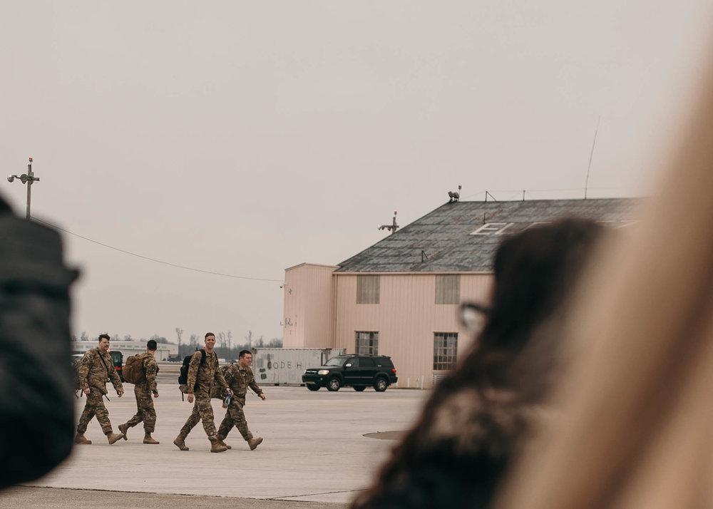 Soldiers Walking off Plane