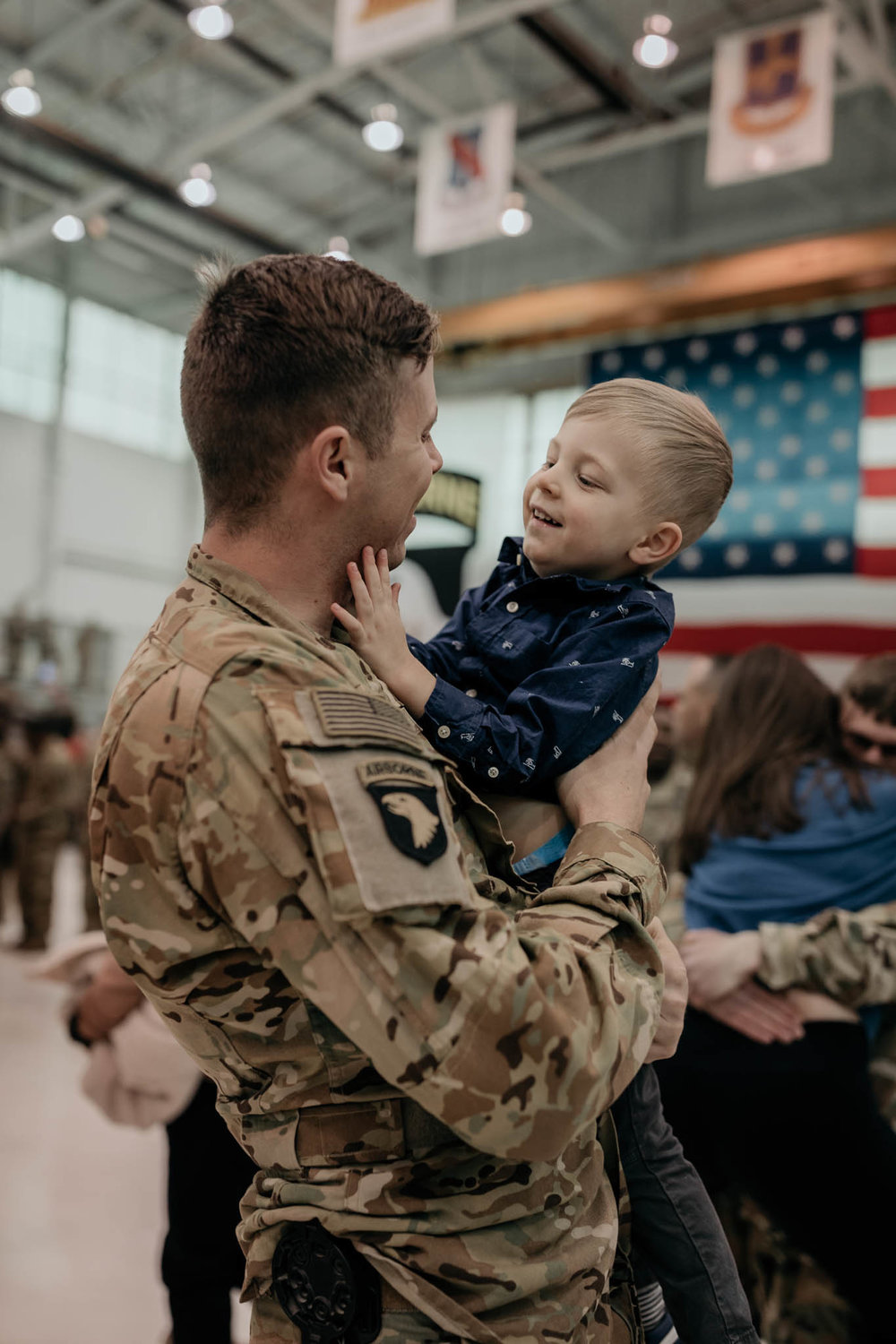 Soldier Holding Son