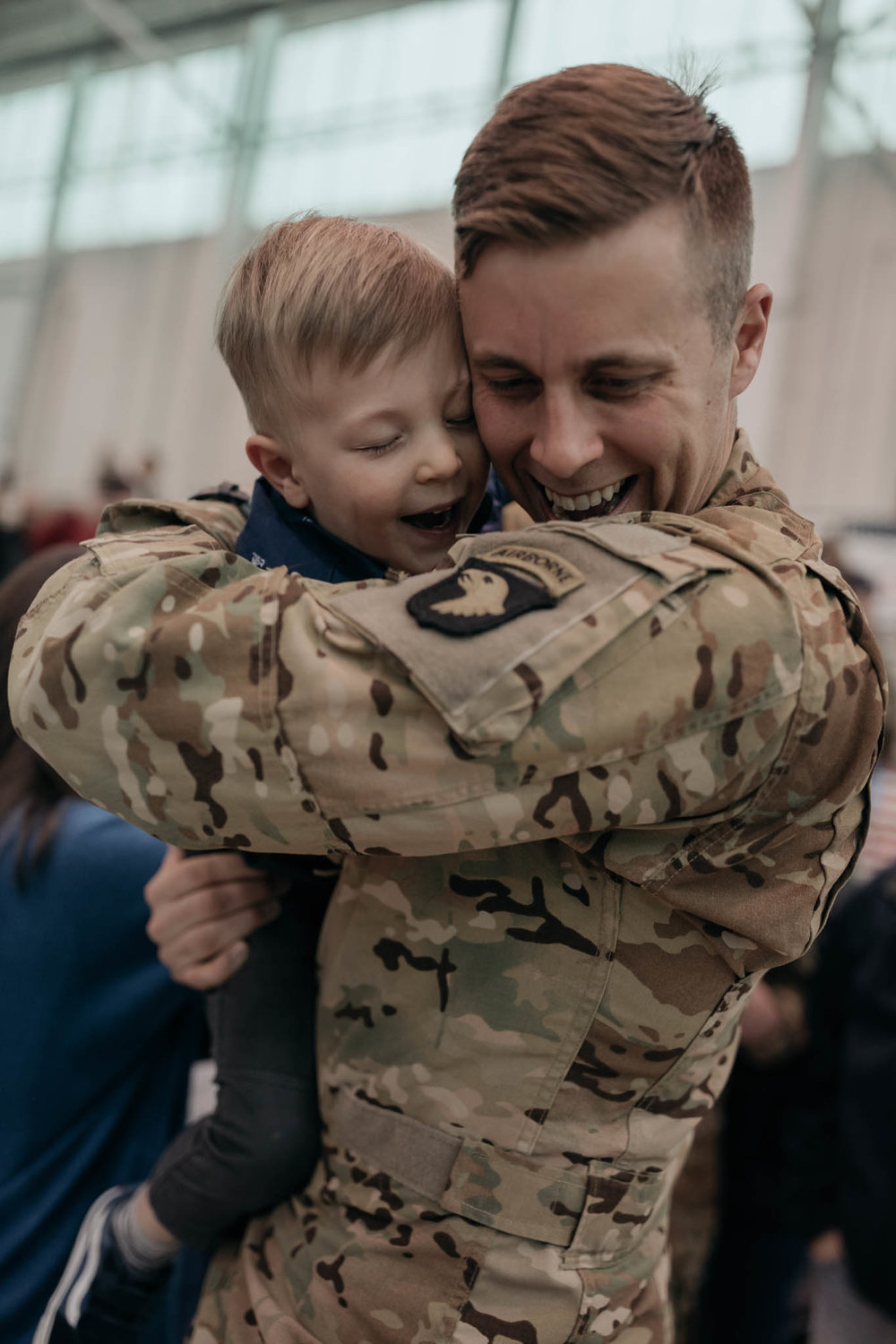 Father Holding and Hugging Son