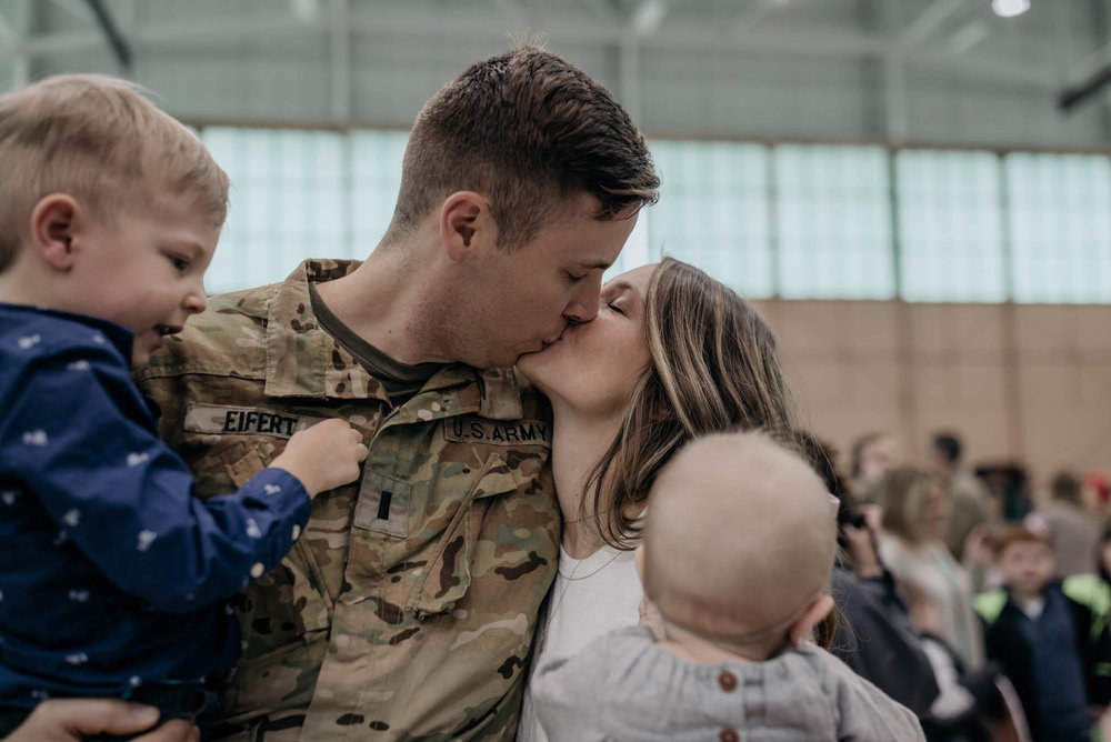 Soldier and Wife Share a Kiss