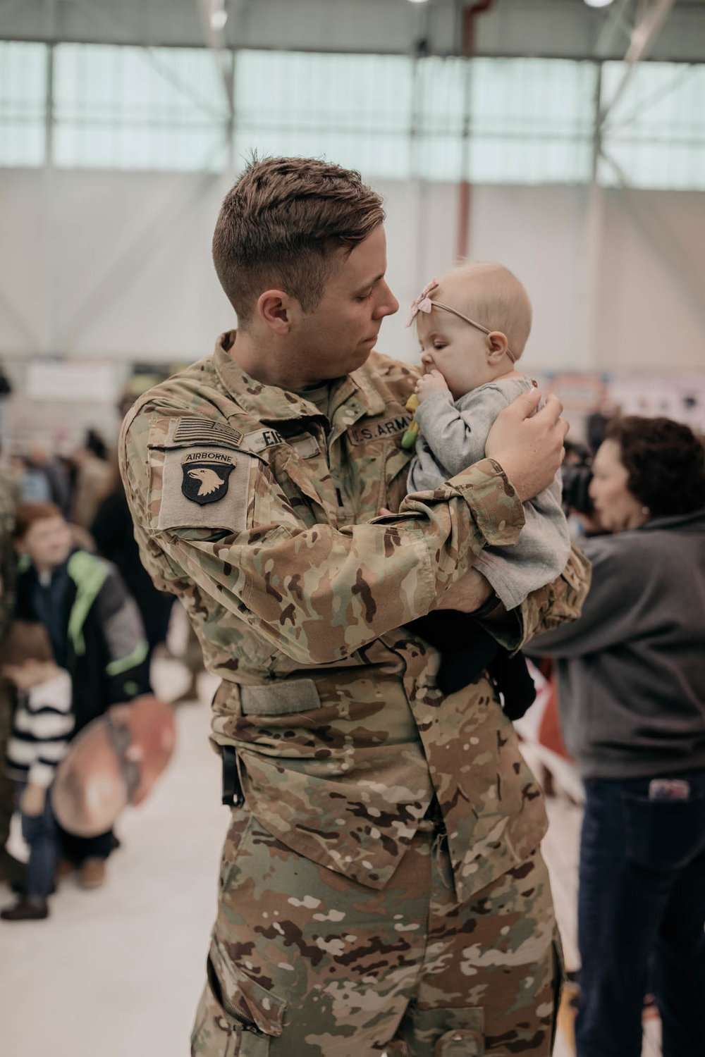 Soldier Holding Daughter