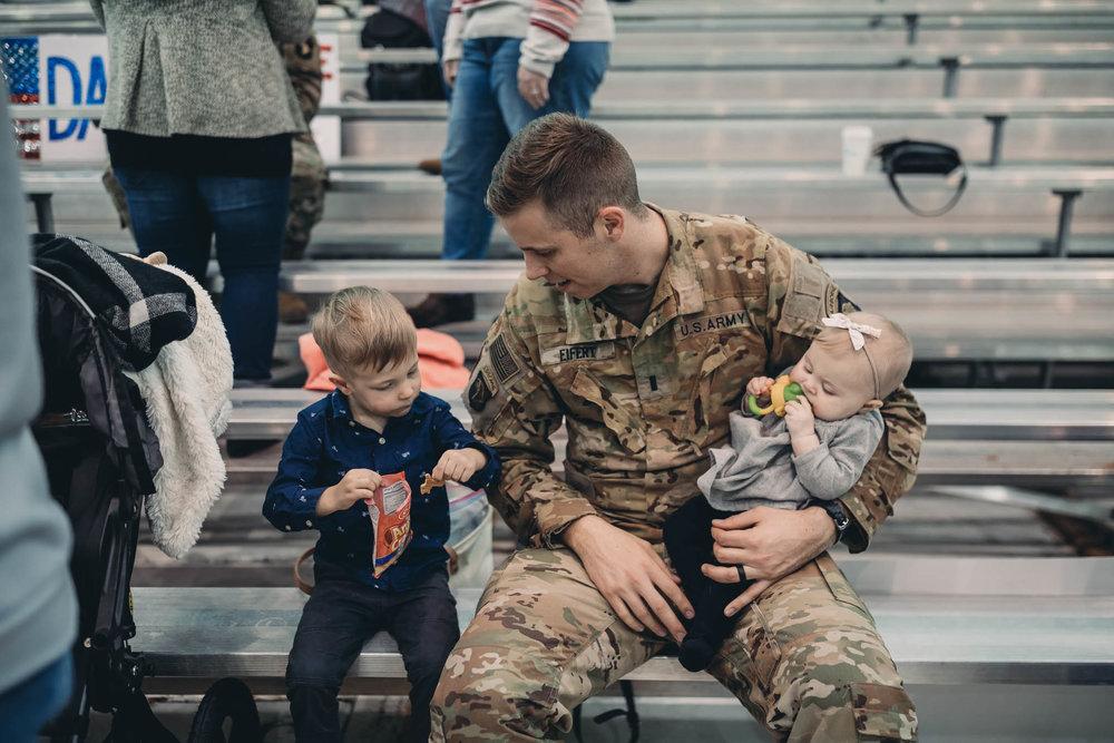 Soldier Sitting with Children