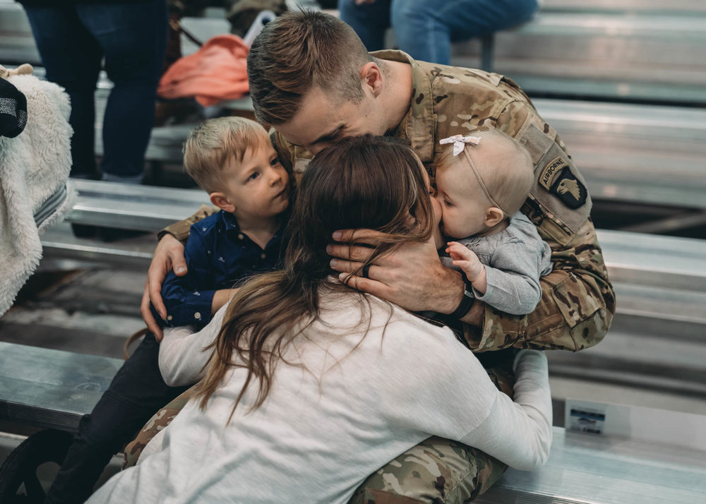 Military Family Sitting and Embracing