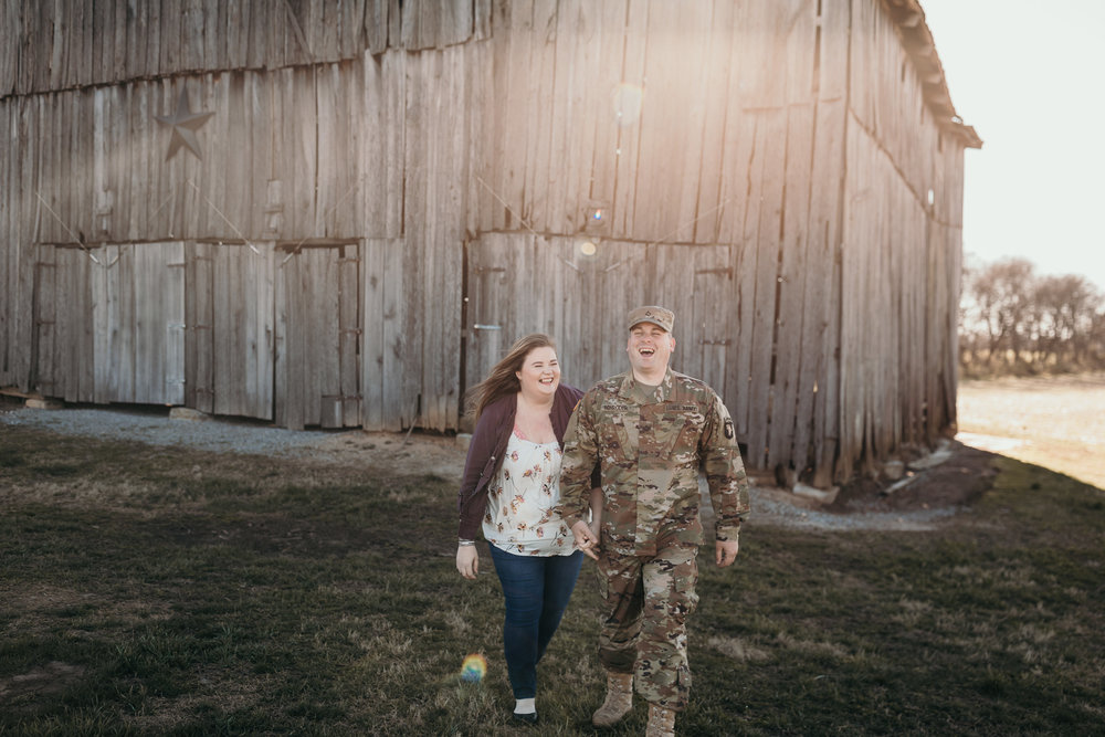 Couple Walking Infront of Barn