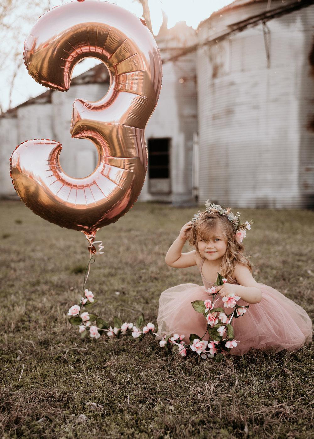 Birthday Girl Sitting in Field