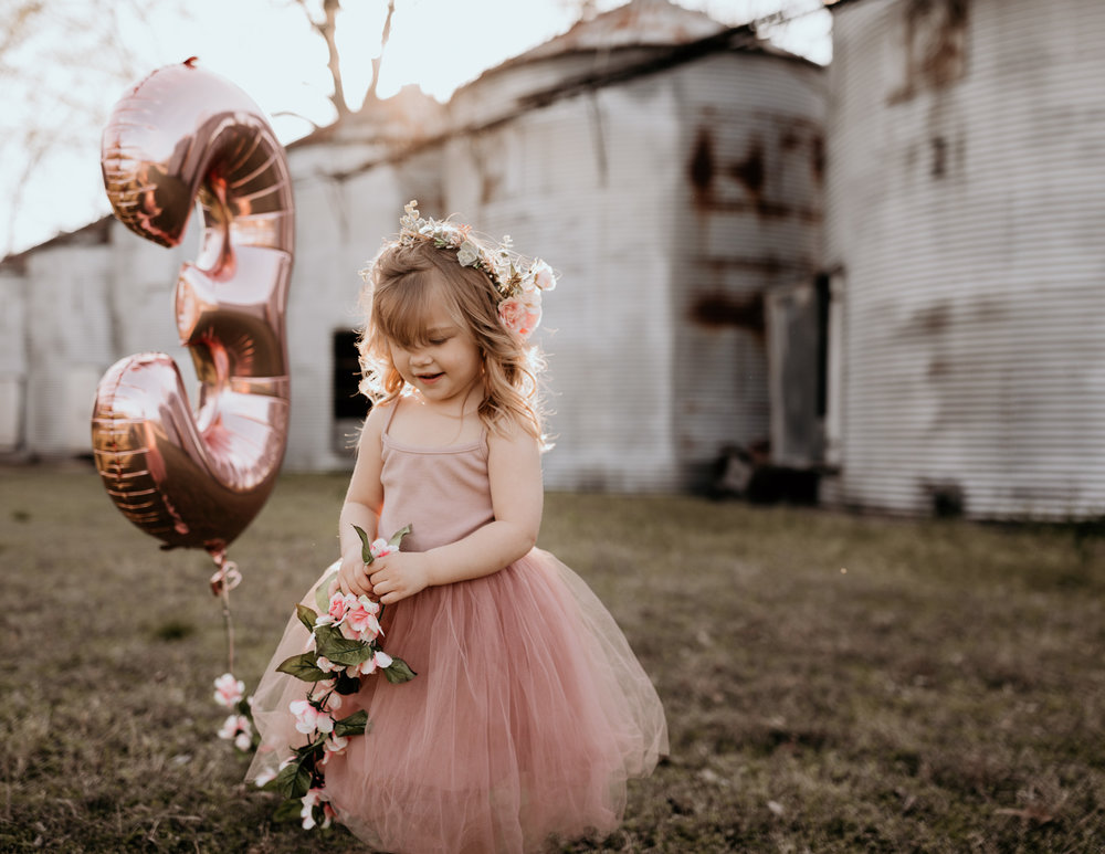 Young Girl Holding Birthday Balloon