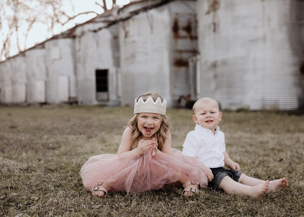 Siblings Photo Sitting in Field