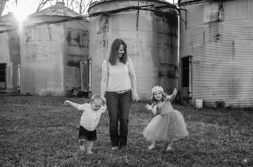 Mother Walking Holding Childrens Hands