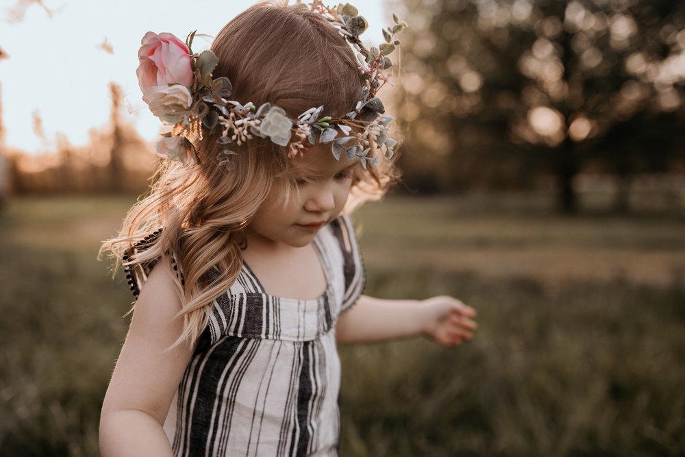 Young Girl Wearing Flower Garland
