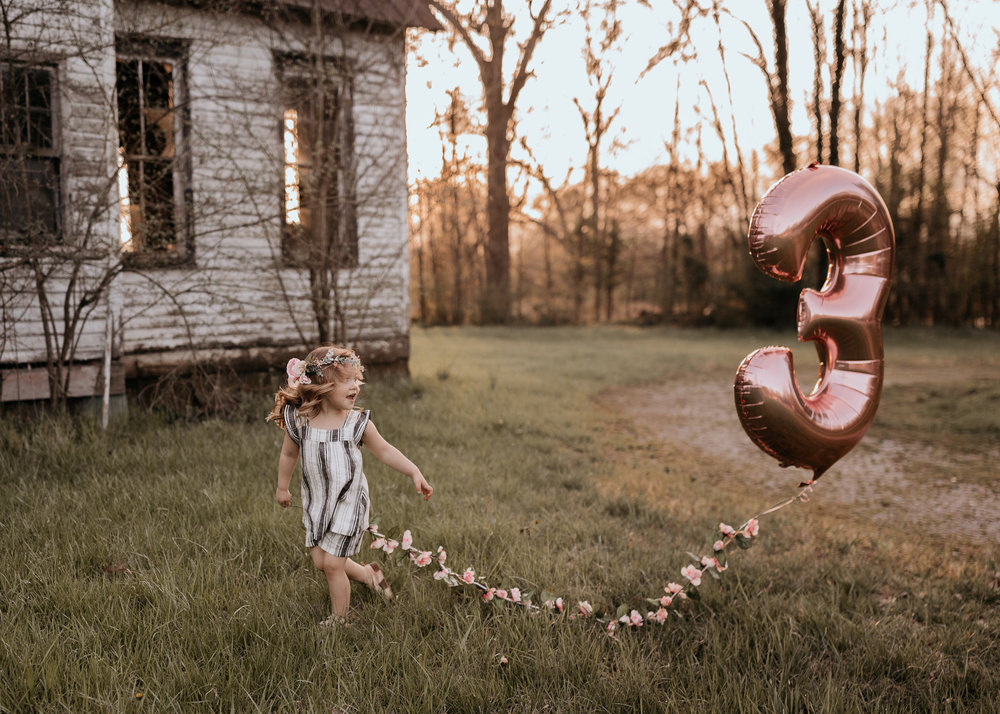 Young Girl Running with Balloon