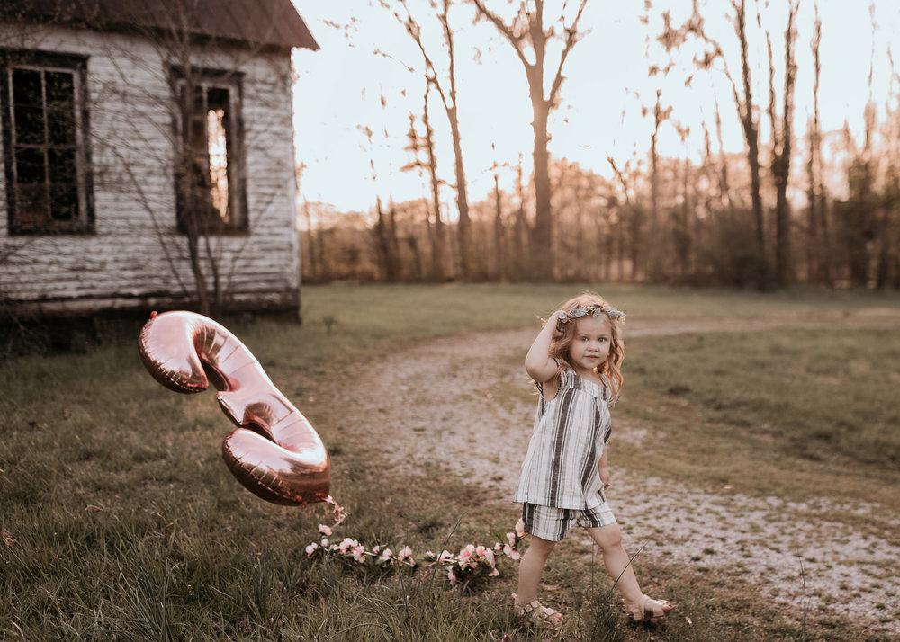 Young Girl Walking with Balloon