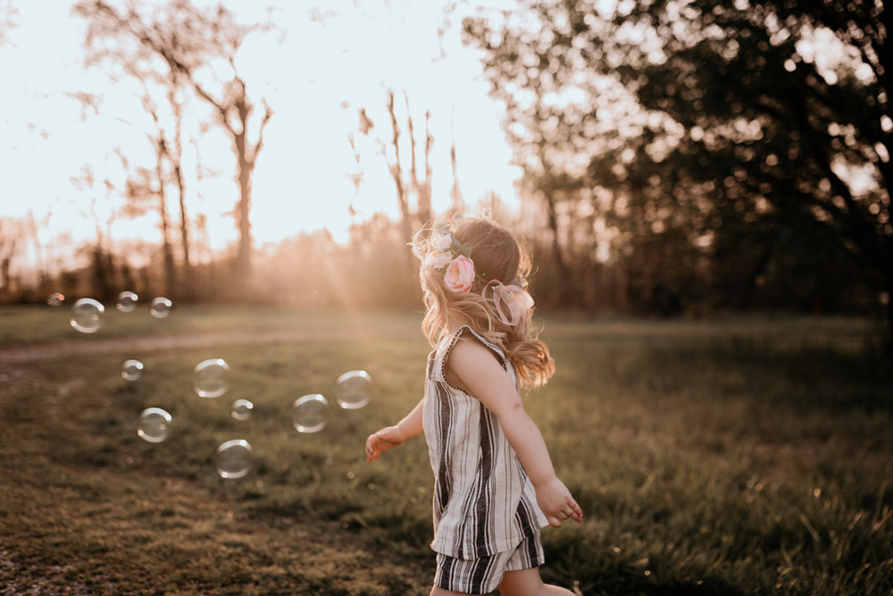 Little Girl with Bubbles and Dreamy Light