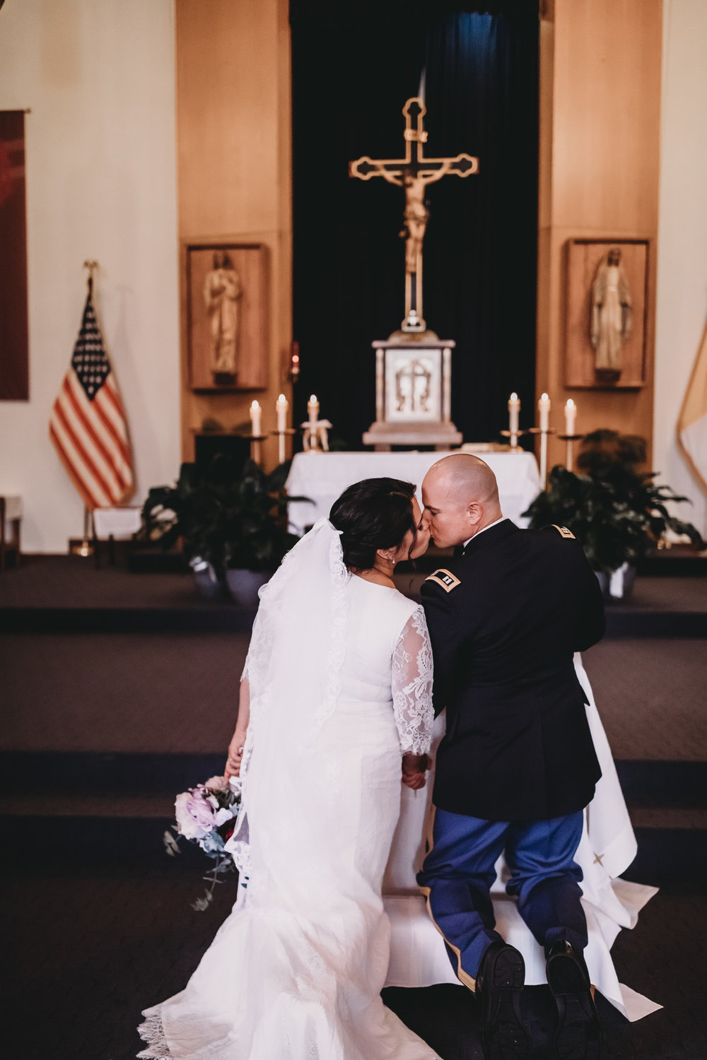 Service Member and Bride Kissing at Alter