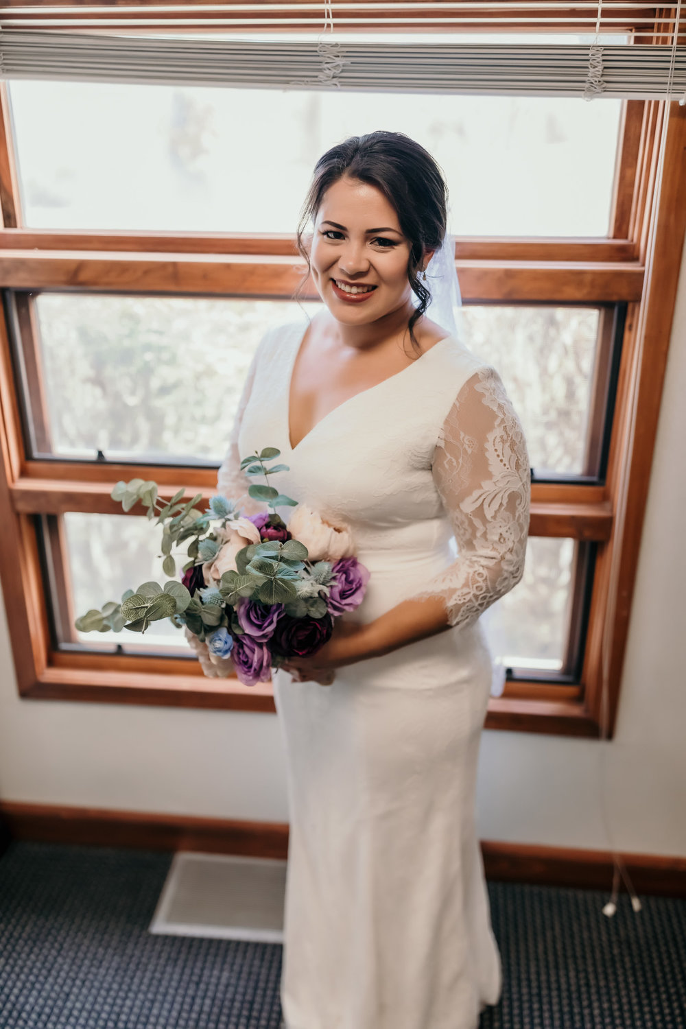 Bride Holding Flowers in Church