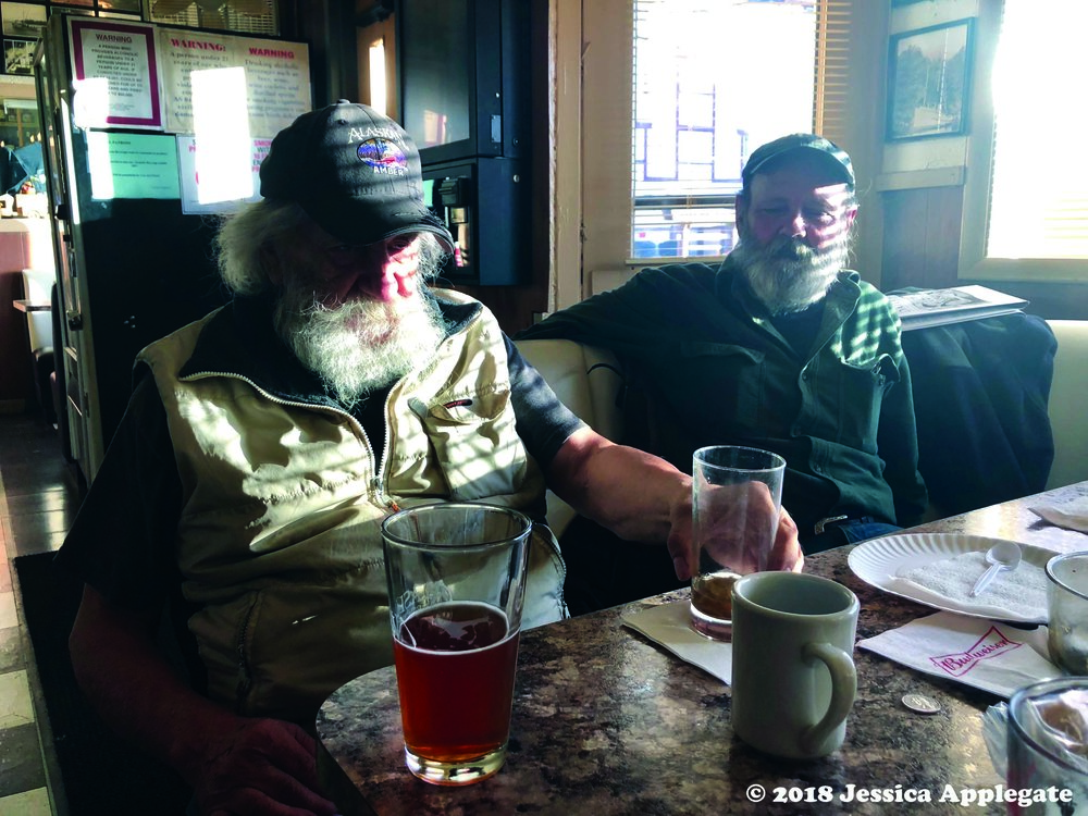 Chester Jackson, left, and Bruce Ulrich, right, discuss fishing in Southeast Alaska.