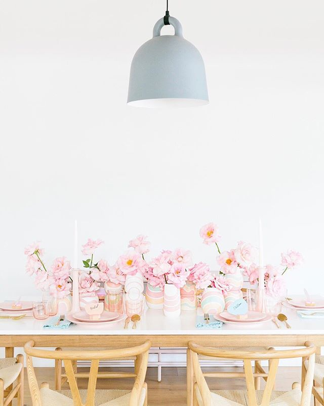 "Celebrating the first day of Spring with some gorgeous custom ceramics from our friends @blackmountainceramic filled with the most stunning blush ""Secret Garden"" roses from @oftheflowers! See the whole Easter brunch setup over on @marthastewart! 🌸 . Hot tip: To achieve this opened bloom affect, Felisa uses a technique called reflexing in which you roll out the outer petals of the rose on your thumb so that they are nice and big!! 🌷 . Design: @butfirstparty  Photo: @billyedonyaphotography  Styling: @bonjourfete  Tabletop: @yearandday  Linens: @wolfandirving  Place holders: @essellesf  Stationary: @alyxhouse"