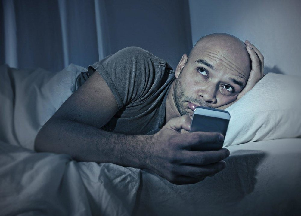young-cell-phone-addict-man-awake-night-bed-smartpho.jpg