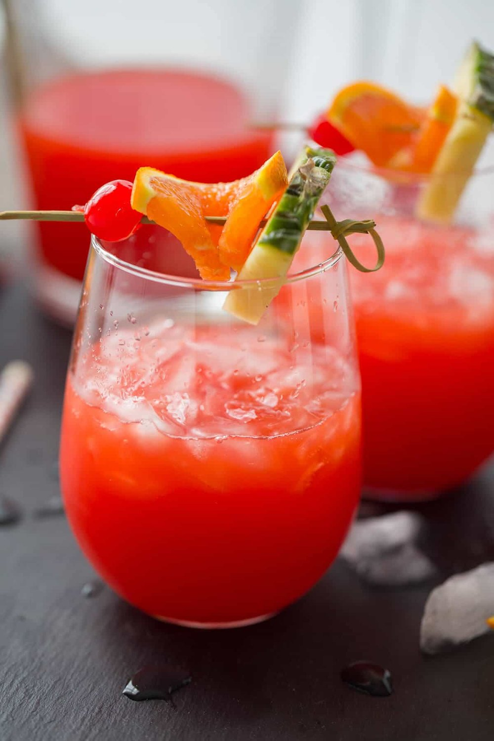 Rum punch Recipe -  1 cup of orange juice1 cup of pineapple juice1/4 cup lime juice1/4 cup rum1/4 cup dark rum1/2 cup of grenadine In a pitcher, combine the juices, the rum, and the grenadine.  Stir. Pour into ice-filled glasses and serve with an orange slice and maraschino cherries. Enjoy responsibly!