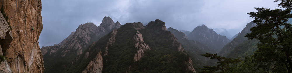 Panorama of Seoraksan National Park.  South Korea's very own Yosemite (climber on left wall).