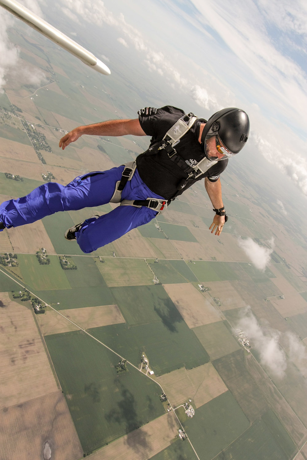 Skydiver steps out into the skies