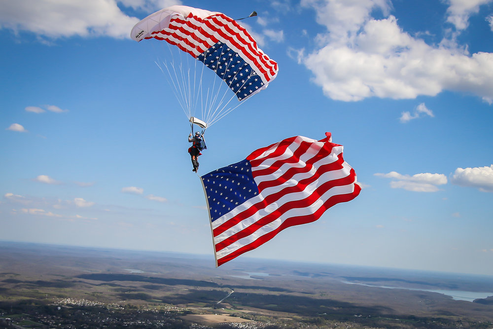 Skydiver flies the American Flag