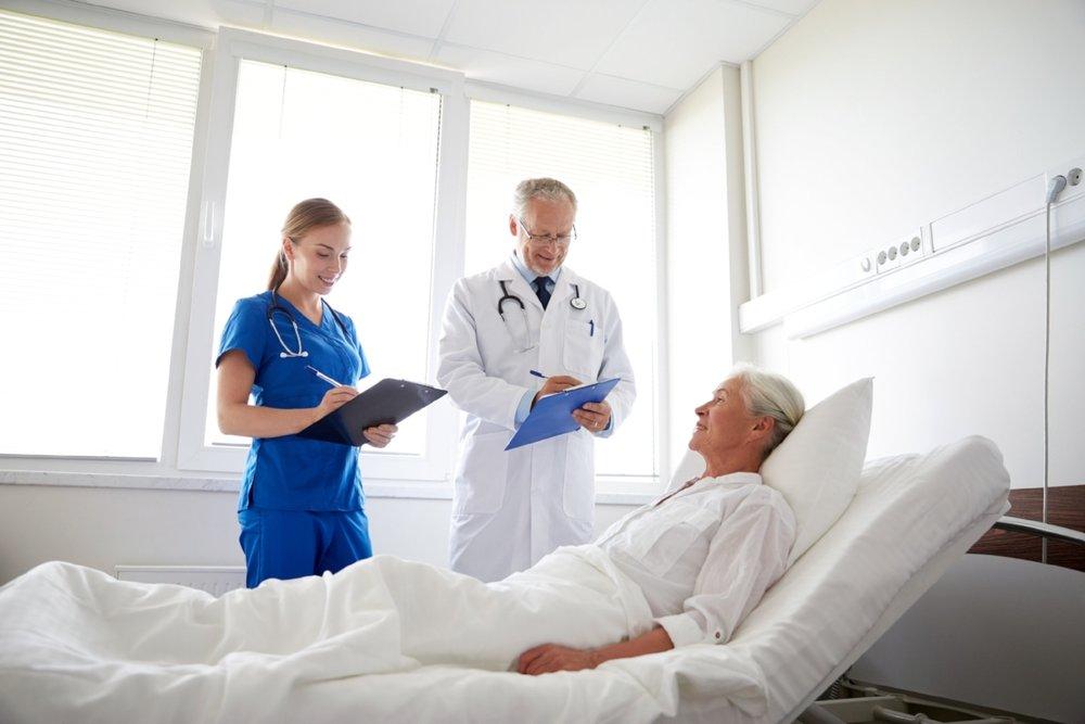 doctor-and-nurse-visiting-senior-woman-at-PA27SYD.jpg