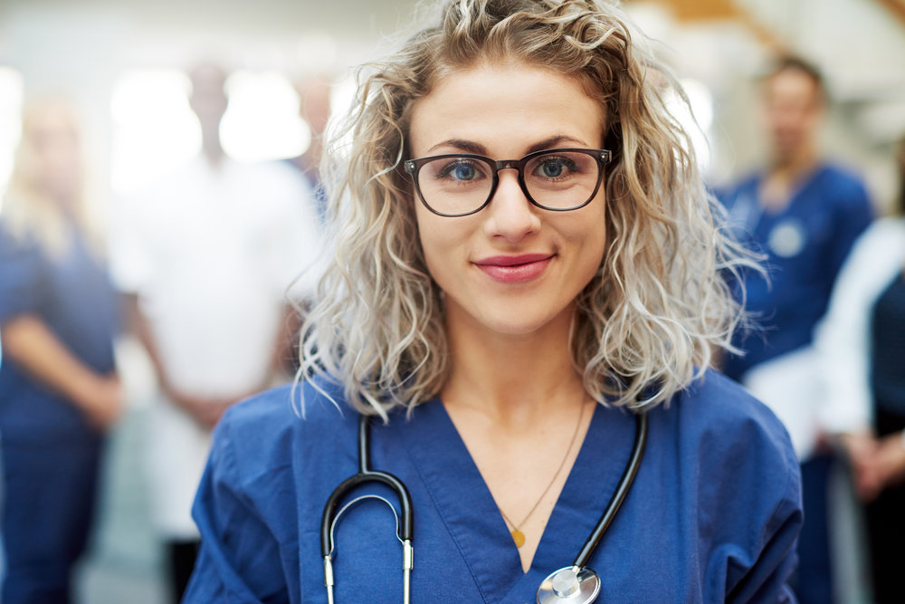 pretty-medic-in-hospital-looking-at-camera-PYN9BVZ.jpg