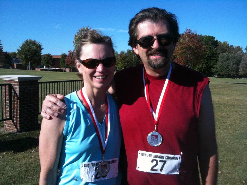 Kathy, Bill running medals.jpg