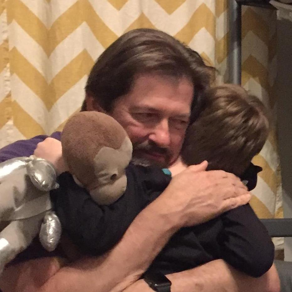 Bill hugging Jim.jpg