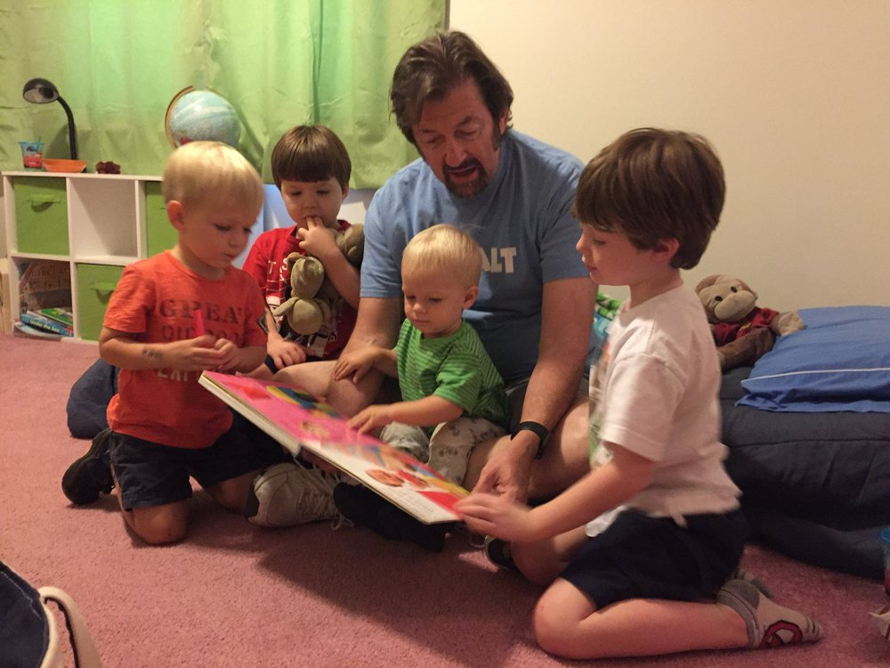 Bill reading to grandsons.jpeg