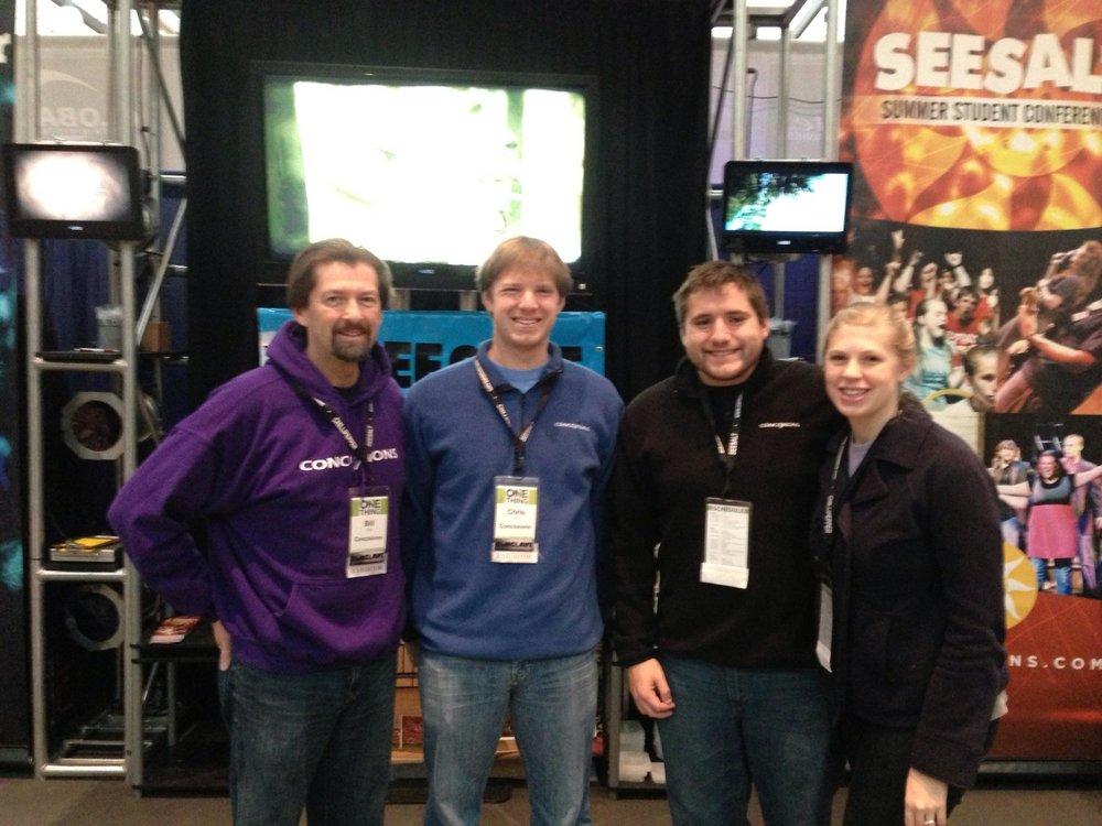 Bill, Chris, Robin, Shari at Conclave booth.jpg