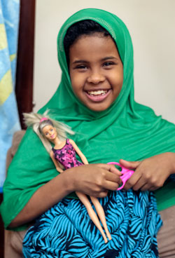 Child-with-barbie-doll.jpg