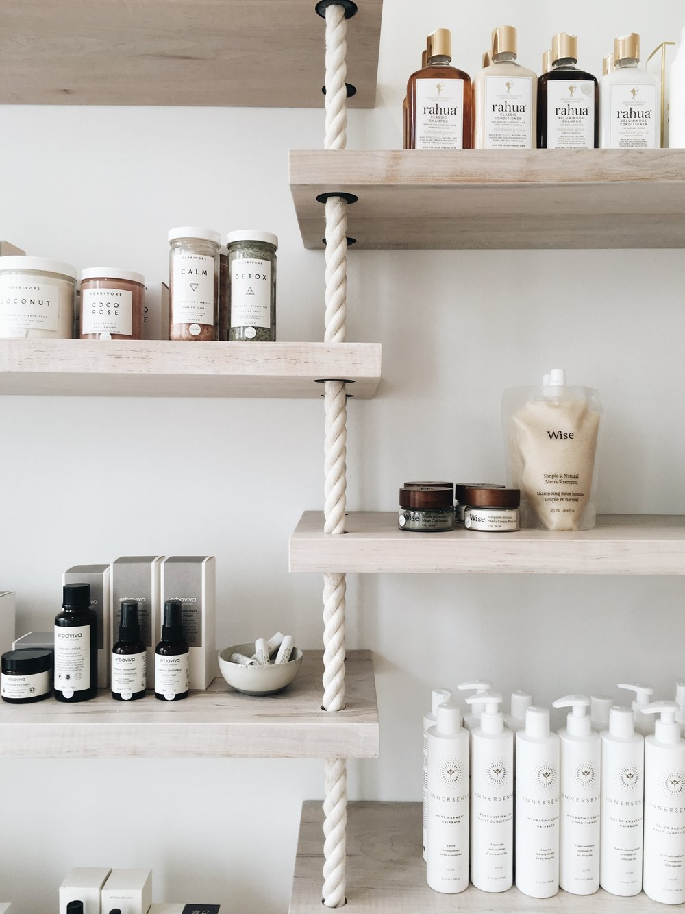 A shelf filled with skincare products