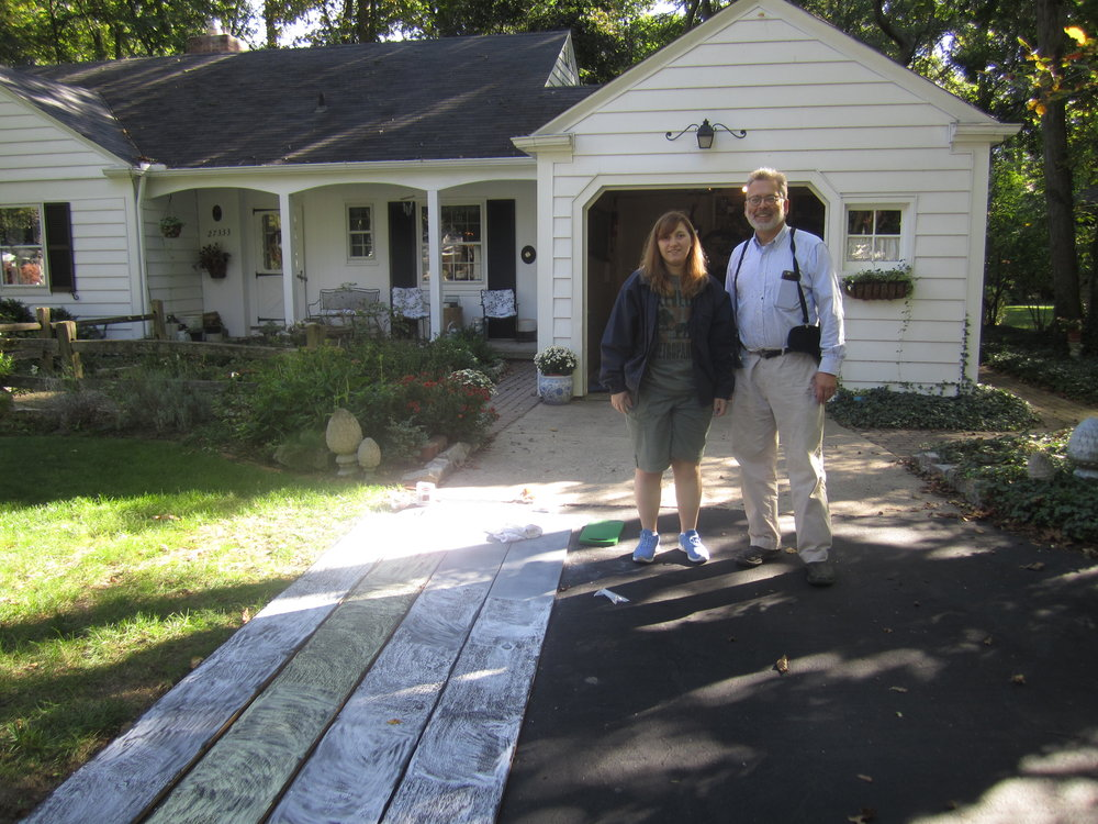 Will Krause and Carolyn Bedell standing next to Chalkboard.JPG