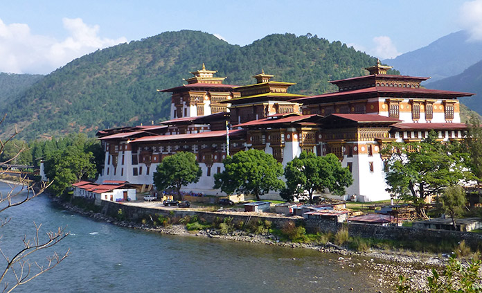Bhutan Multi-Adventure Tour - As prayer flags flutter in the wind, hike ancient footpaths, bike to serene temples, visit remote monasteries and enjoy the warmth of the Bhutanese people.